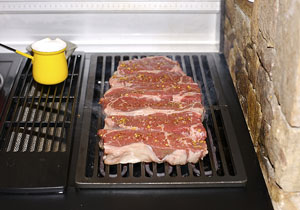 grilling steaks on an electric grill